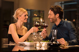 Couple toasting wineglasses - 105322151