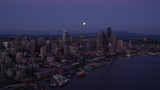 Aerial view of moon over Seattle Skyline