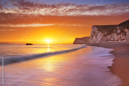 Poster Cliffs at Durdle Door beach in Southern England at sunset