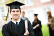 Graduation: Cheerful Graduate with Diploma