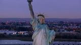 Statue of Liberty at dusk, aerial shot - 105446537