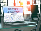 Software Development Concept - Closeup on Landing Page of Laptop Screen in Modern Office Workplace. Toned Image with Selective Focus. 3D Render.