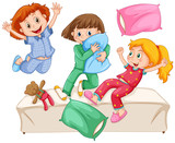 Fototapety Three girls playing pillow fight at the slumber party