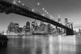 Brooklyn Bridge at dusk viewed from the Brooklyn Bridge Park in New York City. © davidevison