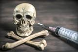 still life Human skull and crossbones drug addict concept