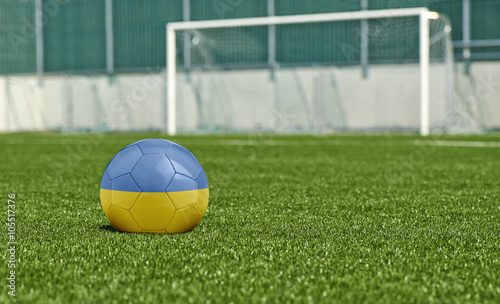 Foto op Canvas Stadion Soccer ball on the green field- flag Ukraine