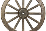 Side view of weathered  wooden wagon wheel on white