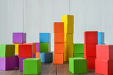 Colorful stack of wood cube building blocks - 105527140