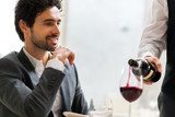 Waiter pouring red wine to a man - Fine Art prints