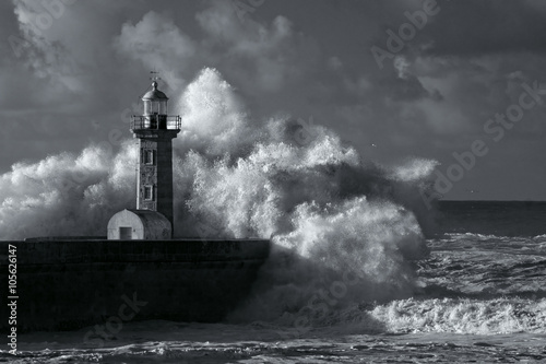 Infrared stormy waves over old lighthouse