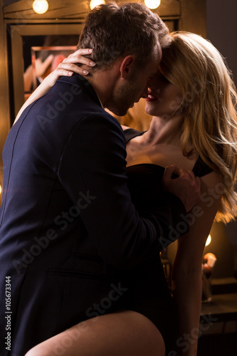Passionate elegant couple during foreplay