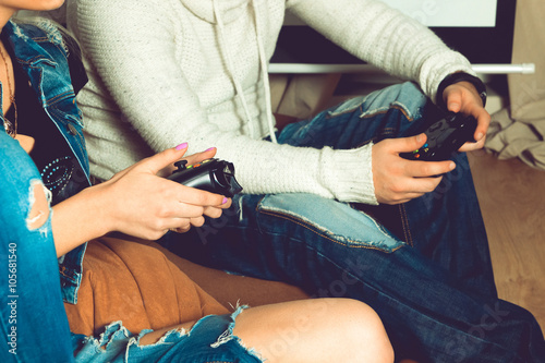 Poster Photo of hands of woman and man with joystick
