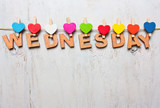Wednesday word from wooden letters on a white wooden background