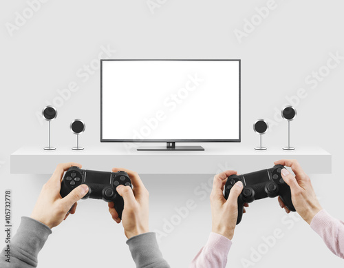 Poster Man hold gamepad in hands in front of blank tv screen mock up player