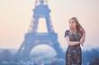 Beautiful elegant Parisian woman near the Eiffel tower