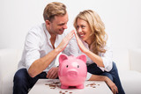 Couple saving money to buy house - 105782517
