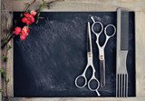 Hair Cutting and Thinning Scissors on vintage background. Hairdresser salon concept. Haircut accessories, flat lay