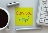 Can We Help, message on note paper, computer and coffee on table