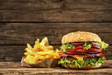 Fototapety Delicious hamburger on wooden table