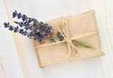 Fototapety Handmade simple cute gift wrapping. Gift box in parchment paper and dried lavender twig decor.