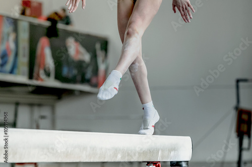 girl gymnast athlete during exercise on balance beam in gymnastics competitions Poster