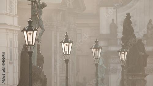 Fototapeta Street lamps on Charles bridge in the morning Prague