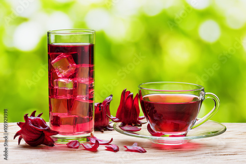 Magenta hibiscus tea (karkade, red sorrel) on nature background