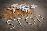 Stop smoking background with broken cigarettes