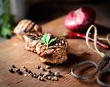 roasted fillet medallion on a wooden background