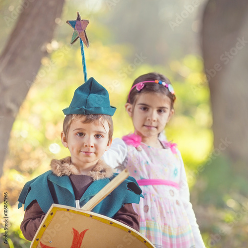 Zdjęcia na płótnie, fototapety, obrazy : Cute little children dressed up as a fairy and a knight playing in a dreamlike nature