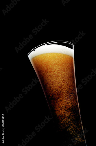 Glass of beer on black background Poster