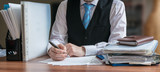 Lawyer is analysing contract in office. - 106142904
