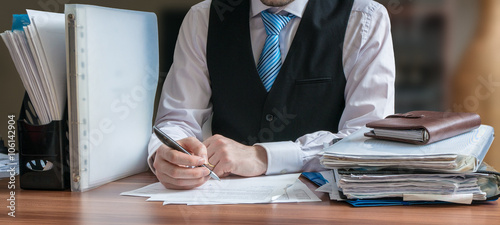 Lawyer is analysing contract in office.