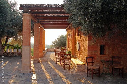 Rural greek outdoor restaurant on pergola terrace, Greece