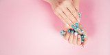 beautiful manicure. gel polish coating in white and turquoise, s