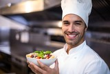 Handsome chef presenting pasta