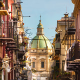 Fototapety View at the church of San Matteo located in heart of Palermo, Italy, Europe.  Traditional Italian medieval city center with typical narrow residential street.