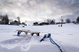 Blue childrens sleigh with ski lift in snowy country