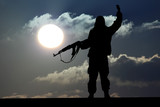 Silhouette of military soldier or officer with weapons at sunset