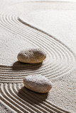 zen sand still-life - two stones showing different directions for concept of evolution or progression with inner peace