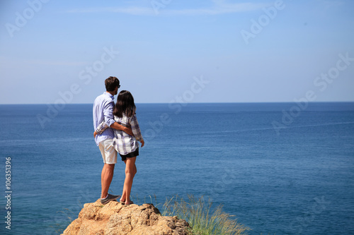 Poster Young couple by the sea