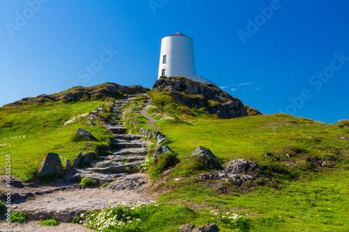 White lighthouse on Llanddwyn Island, Anglesey - 106382568