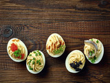 stuffed eggs on wooden table