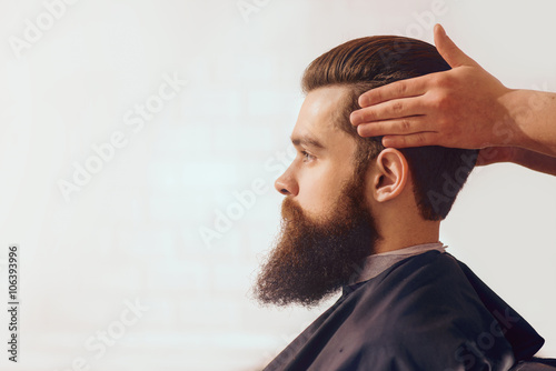 Bearded man sitting in the barbershop