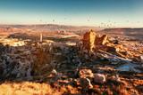 Balloons over Uchisar town in Cappadocia. - 106423355