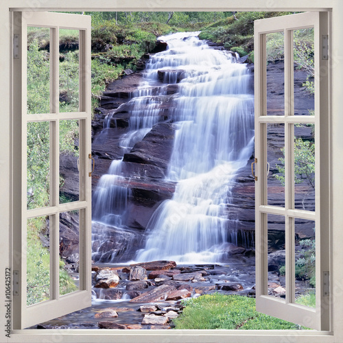 Open window view to small waterfall