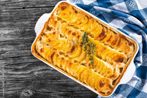 Au Gratin Dauphinois, Potatoes baked in a baking dish, close-up Poster