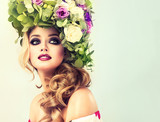 Fototapety Girl spring . Beautiful model with flower wreath on his head . Makeup smoky eyes . Summer girl with trendy makeup .