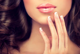 Fototapety Luxury fashion style, manicure nail , cosmetics and make-up .  French nails , hairstyle wave long hair