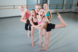 Fototapety Group of young girls having fun in dance studio